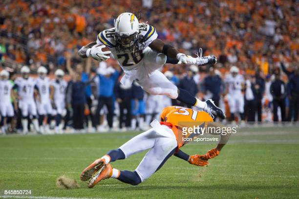 Los Angeles Chargers running back Melvin Gordon dives into the end zone for a touchdown during the second quarter of the NFL game between the Los...