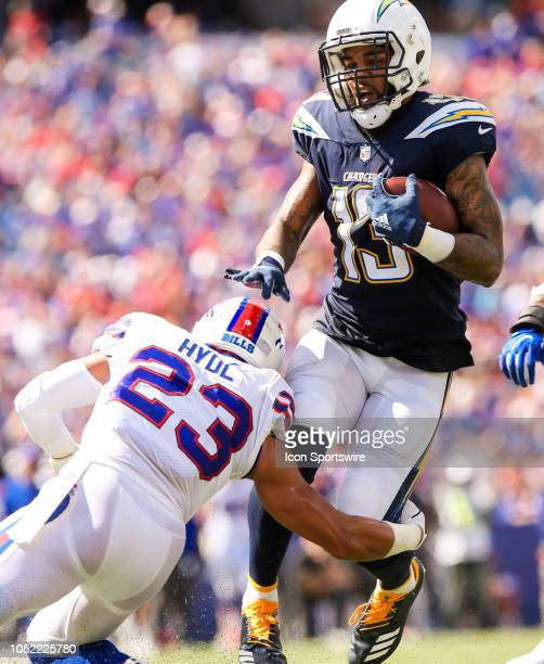 Los Angeles Chargers wide receiver Keenan Allen is tripped up by Buffalo Bills defensive back Micah Hyde during a game between the San Diego Chargers...