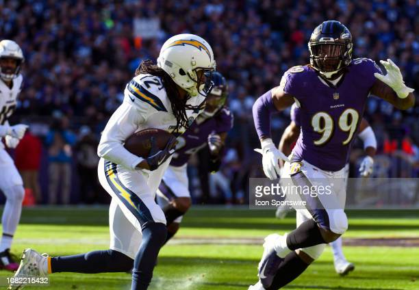 Los Angeles Chargers wide receiver Travis Benjamin makes a reception against Baltimore Ravens outside linebacker Matt Judon on January 6 at MT Bank...