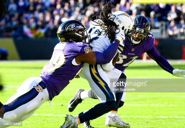 Los Angeles Chargers wide receiver Travis Benjamin makes a reception and is tackled by Baltimore Ravens outside linebacker Matt Judon and free safety...