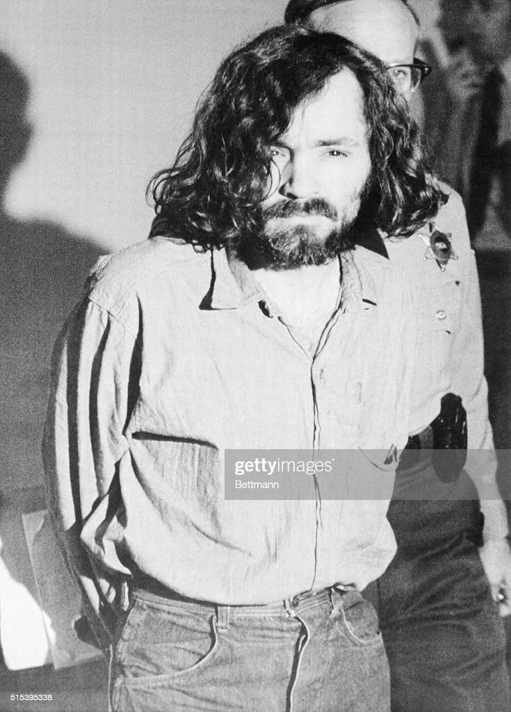 Charles Manson heads for court where he took the witness stand at the Tate-LaBianca murder trial to complain about the 'humiliation' to which he says he is being subjected to in the county jail. Dressed in prison denims, his hair stringy and uncombed, the 35-yr-old ex-convict testified outside the presence of the jury on the motion to force the sheriff to end the 'harassment' of the numerous daily 'shakedowns' and to be able to meet privately with his attorney and not in the presence of a deputy.