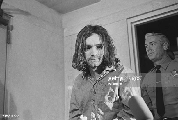 Charles Manson hippie cult leader and accused mastermind in the killing of Sharon Tate and several other persons last year arrives in court to enter...