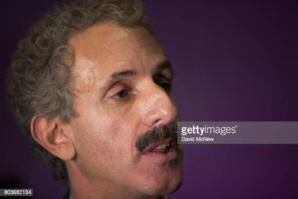 Los Angeles City Attorney Mike Feuer talks to a reporter after a meeting with officials on the first day of the the partial reinstatement of the...