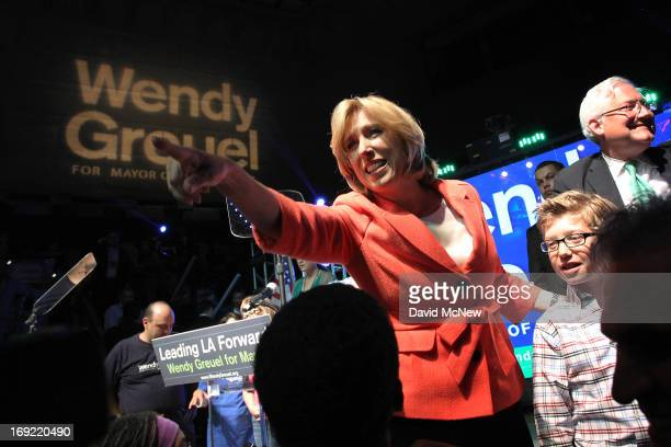 Los Angeles City Controller Wendy Greuel addresses her backers with her son Thomas and husband Dean Schramm at her side on election night of her Los...