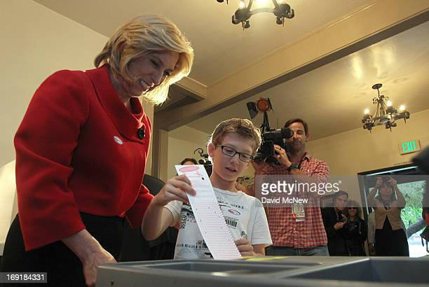 Los Angeles City Controller Wendy Greuel votes with her son Thomas Schramm placing her ballot into the ballot box in her Los Angeles mayoral runoff...