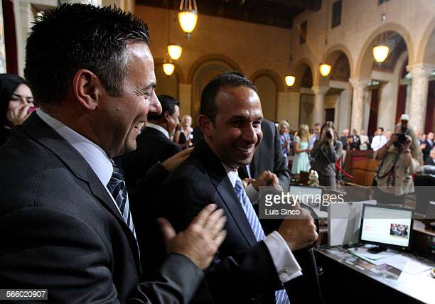 Los Angeles City Councilman Joe Buscaino left congratulates Councilman Mitchell Englander after Englander was elected council vice president on...