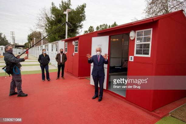 Los Angeles City Councilman Paul Krekorian, right, holds a press conference to announce the first Tiny Homes community will open helping to house...