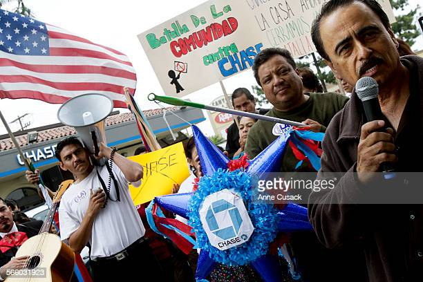 Los Angeles city councilman Richard Alarcon speaks as the civil rights group One LA demonstrate outside Chase Bank at 8301 N Laurel Canyon Boulevard...