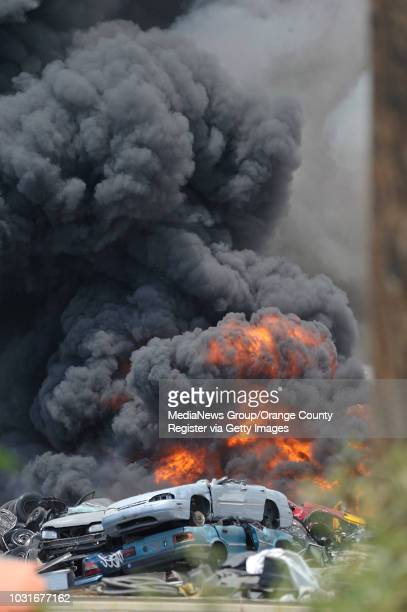 USA Los Angeles City firefighters work to put out a blaze at a scrap metal yard in the 1900 block of North Blinn Avenue Between Lomita Ave and...