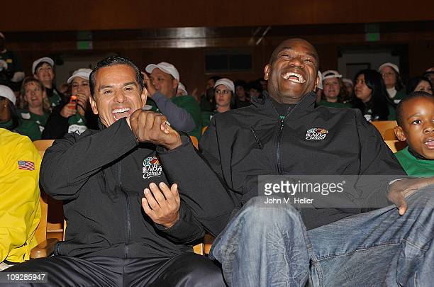 Los Angeles City Mayor Antonio Villiaraigosa and former NBA player Dikembe Mutombo attend the NBA Cares AllStar Day of Service with City Year at...