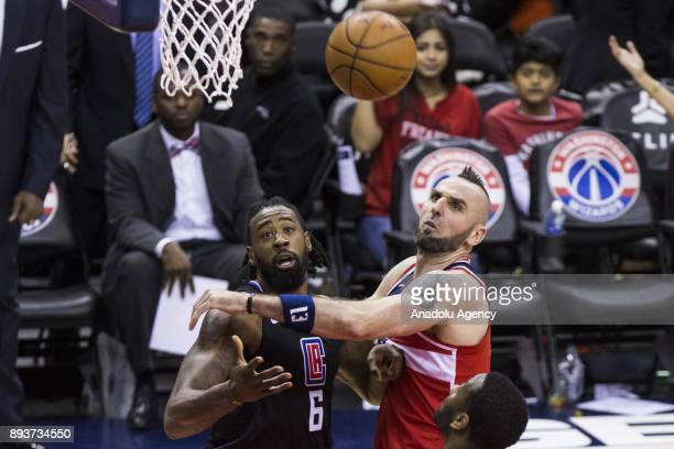 Los Angeles Clipper DeAndre Jordan and Washington Wizard Marcin Gortat go for a rebound at the Capital One Arena in Washington USA on December 15 2017