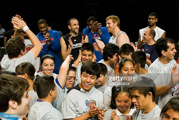 Los Angeles Clippers and San Antonio Spurs players Craig Smith Manu Ginobili AlFarouq Aminu Matt Bonner and Tim Duncan play with children with Down...