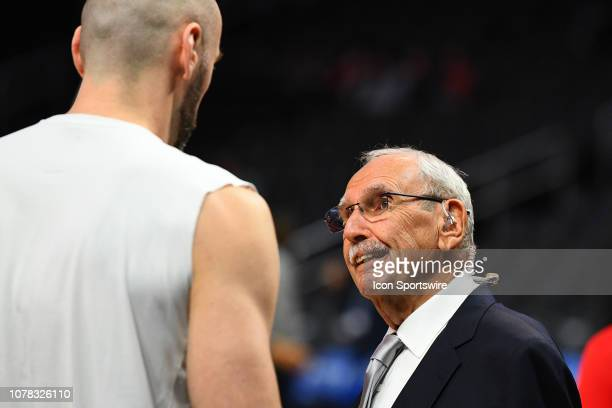 Los Angeles Clippers announcer Ralph Lawler talks with Los Angeles Clippers Center Marcin Gortat before a NBA game between the Orlando Magic and the...