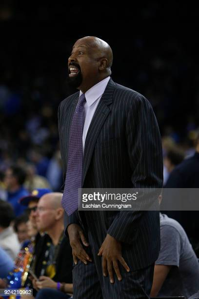 Los Angeles Clippers assistant coach Mike Woodson looks on from the bench during the game against the Golden State Warriors at ORACLE Arena on...