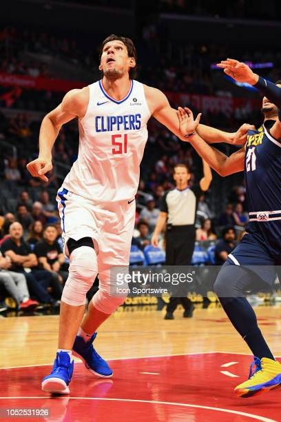 Los Angeles Clippers Center Boban Marjanovic boxes out Denver Nuggets Guard Jamal Murray for a rebound during an NBA preseason game between the...