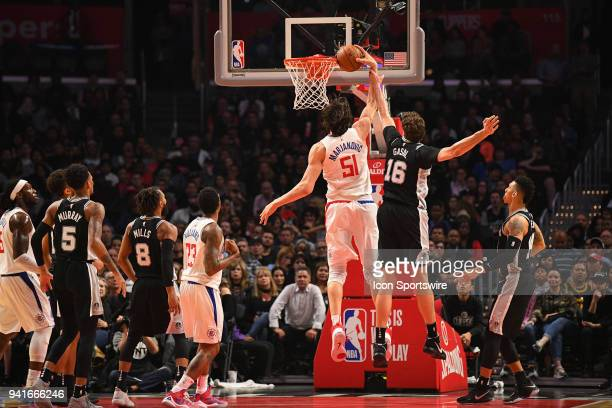 Los Angeles Clippers Center Boban Marjanovic is fouled by San Antonio Spurs Center Pau Gasol during an NBA game between the San Antonio Spurs and the...