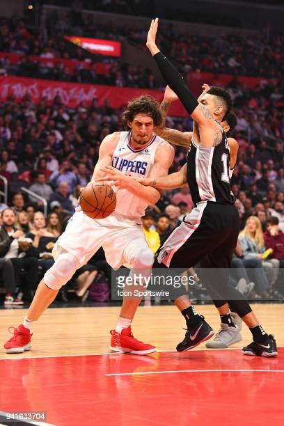 Los Angeles Clippers Center Boban Marjanovic is guarded closely by San Antonio Spurs Guard Danny Green during an NBA game between the San Antonio...