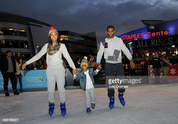 Los Angeles Clippers' Chris Paul skates with his wife and son during AEG's Season of Giving event at Nokia Plaza LA Live on December 19 2013 in Los...