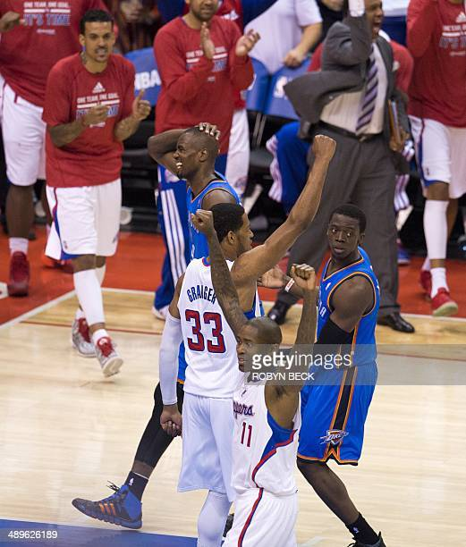 Los Angeles Clippers Danny Granger and Jamal Crawford celebrate as Oklahoma City Thunder Serge Ibaka and Reggie Jackson react after the Clippers...