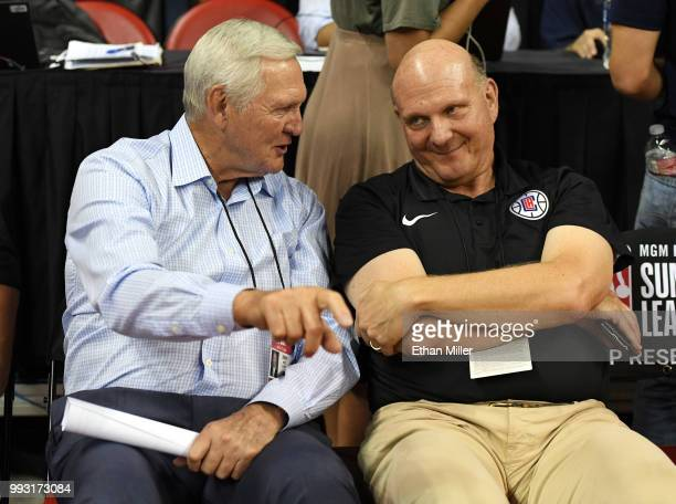Los Angeles Clippers executive board member Jerry West and Clippers owner Steve Ballmer talk as they attend a 2018 NBA Summer League game between the...