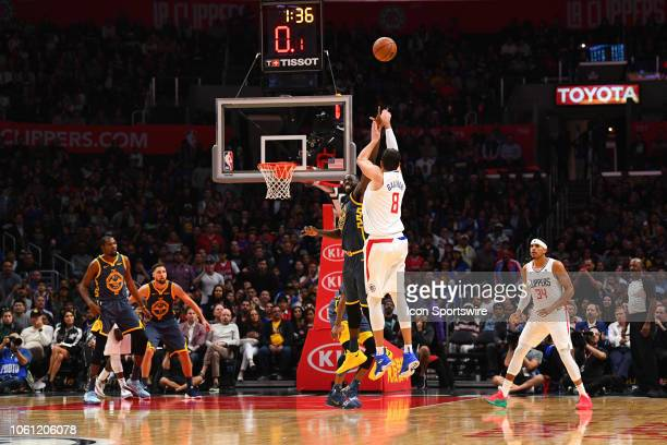 Los Angeles Clippers Forward Danilo Gallinari shoots over Golden State Warriors Forward Draymond Green as the shot clock winds down during a NBA game...