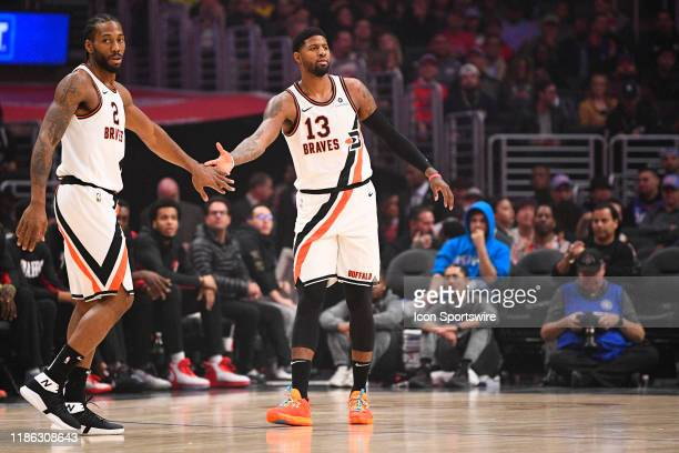 Los Angeles Clippers Forward Kawhi Leonard and Los Angeles Clippers Guard Paul George give each other a high five during a NBA game between the...