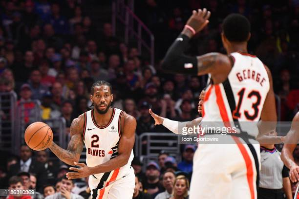 Los Angeles Clippers Forward Kawhi Leonard passes the ball out to Los Angeles Clippers Guard Paul George during a NBA game between the Portland Trail...