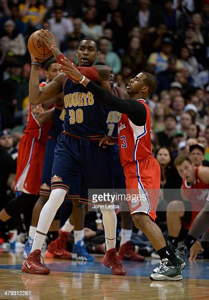 Los Angeles Clippers guard Chris Paul puts pressure on Denver Nuggets forward Quincy Miller during the third quarter March 17 2014 at Pepsi Center