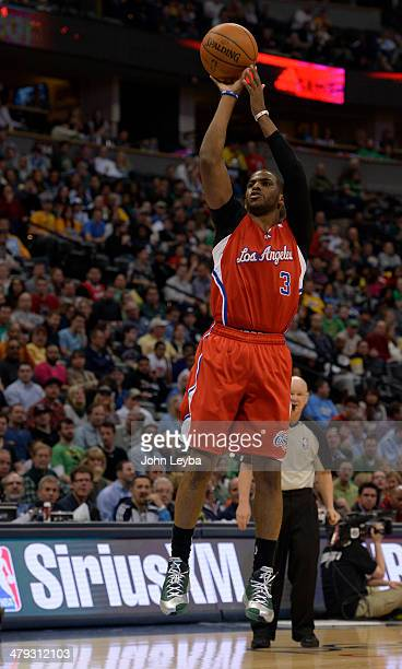 Los Angeles Clippers guard Chris Paul takes a shot during the third quarter against the Denver Nuggets March 17 2014 at Pepsi Center