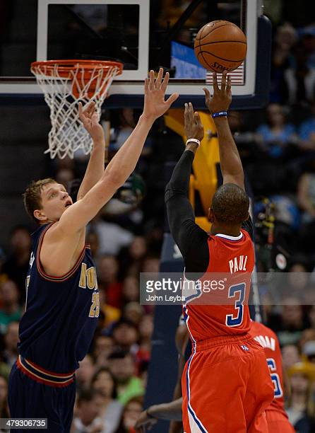 Los Angeles Clippers guard Chris Paul takes a shot over Denver Nuggets center Timofey Mozgov during the first quarter March 17 2014 at Pepsi Center