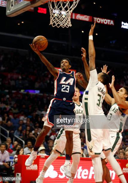 Los Angeles Clippers guard Lou Williams goes up for a layup past Milwaukee Bucks center John Henson during the game on November 10 at Staples Center...
