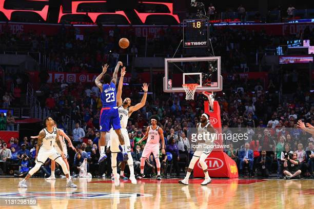 Los Angeles Clippers Guard Lou Williams hits the game winning shot over Brooklyn Nets Guard Spencer Dinwiddie during a NBA game between the Brooklyn...