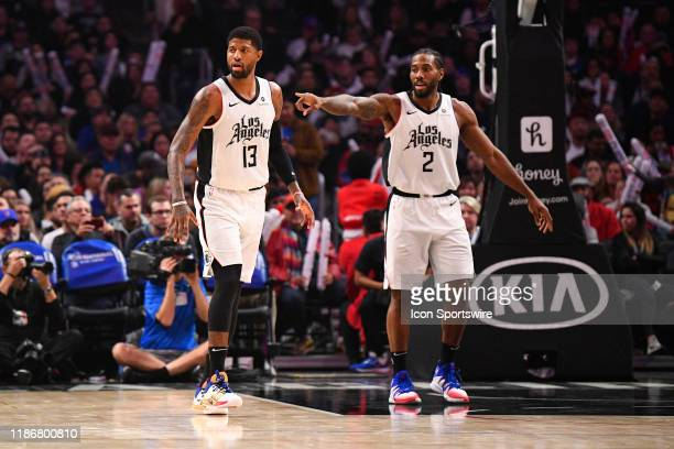 Los Angeles Clippers Guard Paul George and Los Angeles Clippers Forward Kawhi Leonard on defense during a NBA game between the Washington Wizards and...