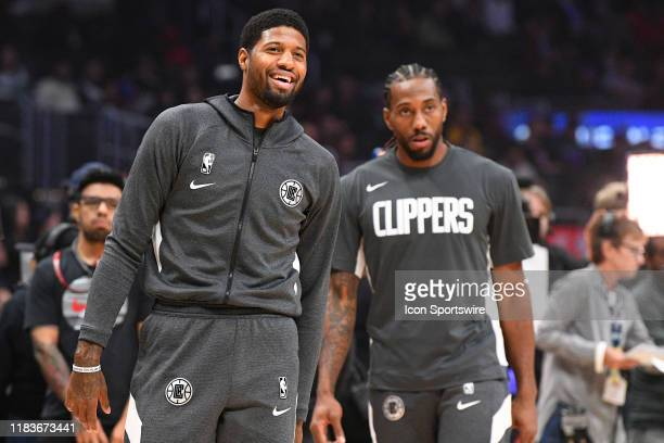 Los Angeles Clippers Guard Paul George and Los Angeles Clippers Forward Kawhi Leonard look on before a NBA game between the Boston Celtics and the...
