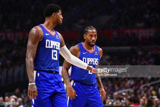 Los Angeles Clippers Guard Paul George and Los Angeles Clippers Forward Kawhi Leonard look on during a NBA game between the New Orleans Pelicans and...