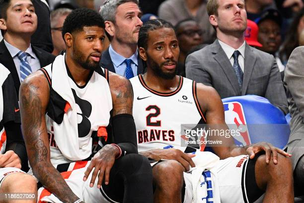 Los Angeles Clippers Guard Paul George and Los Angeles Clippers Forward Kawhi Leonard look on from the bench during a NBA game between the Portland...
