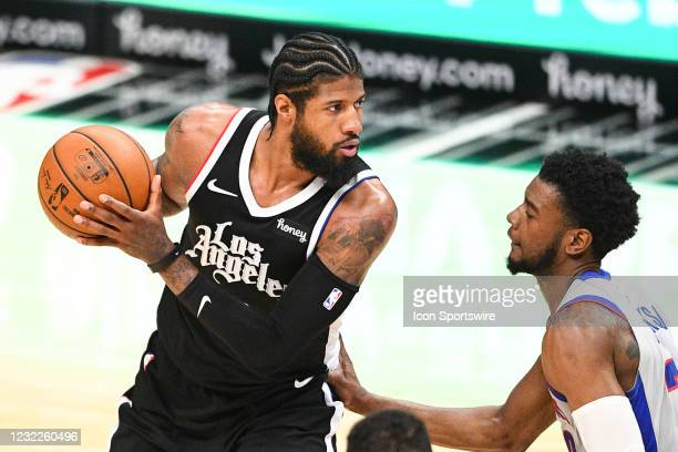 Los Angeles Clippers Guard Paul George closely guarded by Detroit Pistons Guard Josh Jackson during a NBA game between the Detroit Pistons and the...
