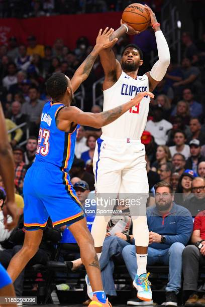 Los Angeles Clippers Guard Paul George shoots a three pointer during a NBA game between the Oklahoma City Thunder and the Los Angeles Clippers on...