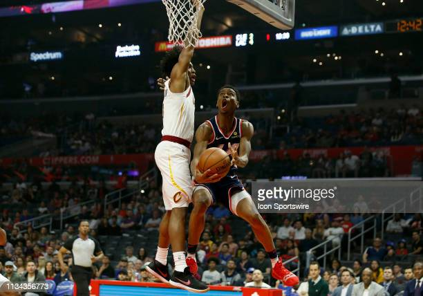 Los Angeles Clippers guard Shai GilgeousAlexander attempts a layup past Cleveland Cavaliers guard Collin Sexton during the game on March 30 at...