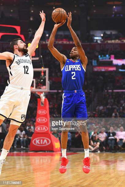 Los Angeles Clippers Guard Shai GilgeousAlexander shoots over Brooklyn Nets Forward Joe Harris during a NBA game between the Brooklyn Nets and the...