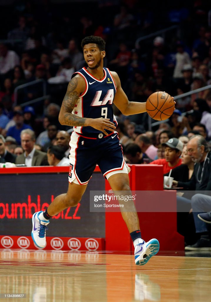 f2360c63b94f Los Angeles Clippers guard Tyrone Wallace dribbles up the court ...