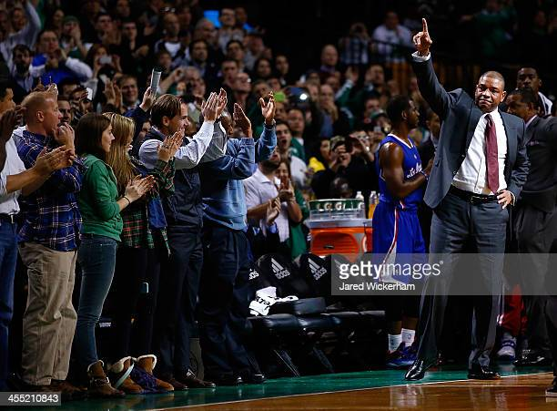 Los Angeles Clippers head coach Doc Rivers acknowledges the crowd at the end of the first quarter against his former team the Boston Celtics...