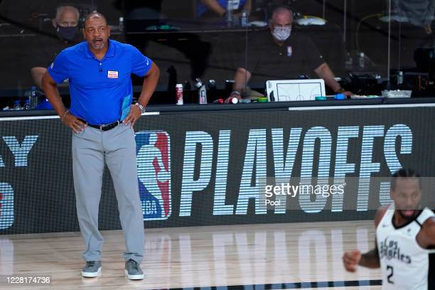 Los Angeles Clippers head coach Doc Rivers watches during the second half of an NBA basketball first round playoff game against the Dallas Mavericks...