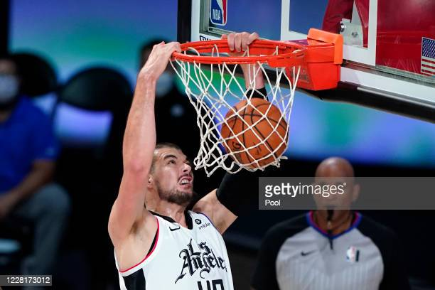 Los Angeles Clippers' Ivica Zubac dunks the ball against the Dallas Mavericks during the first half of an NBA basketball first round playoff game at...