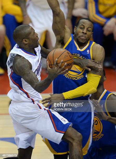 Los Angeles Clippers Jamal Crawford drives to the basket against Golden State Warriors Andre Iguodala during the NBA playoff game 5 between the Los...