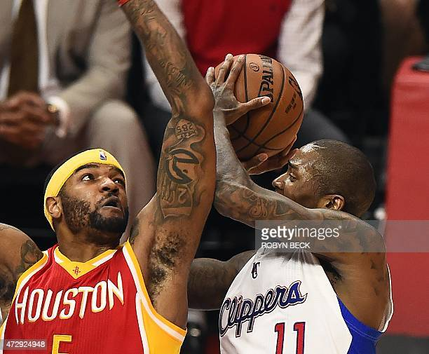 Los Angeles Clippers Jamal Crawford shoots around Houston Rockets Josh Smith in Game Four of their NBA playoff series May 10 2015 at Staples Center...