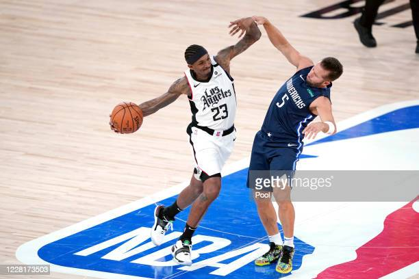 Los Angeles Clippers' Lou Williams drives toward the basket as Dallas Mavericks' J.J. Barea defends during the first half of an NBA basketball first...