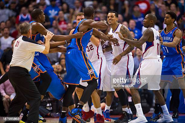 Los Angeles Clippers Matt Barnes and Oklahoma City Thunder Serge Ibaka skirmish in the final seconds of the second quarter during NBA action November...
