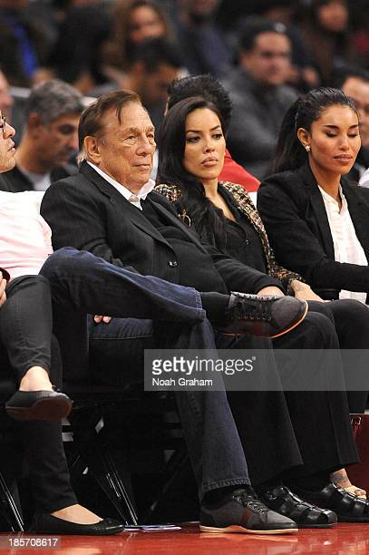 Los Angeles Clippers owner Donald Sterling and V Stiviano look on from their seats during a game against the Utah Jazz at Staples Center on October...