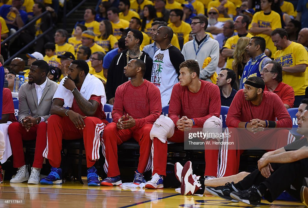 Los Angeles Clippers players sit on the bench wearing their warm-up tops inside out against the Golden State Warriors in Game Four of the Western Conference Quarterfinals during the 2014 NBA Playoffs at ORACLE Arena on April 27, 2014 in Oakland, California. The players wore theirs warm up this way in protest of owner Donald Sterling's racially insensitive remarks.